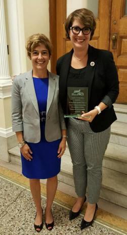 "Rep. Benson Receiving the ""Legislator of the Year"" award."