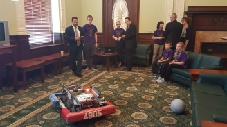Rep. Carlos Gonzalez and Rep. Aaron Vega driving the robot.