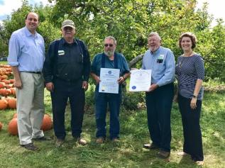 Celebrating the 80th anniversary of the founding of Carlson Orchards with Sen. Eldridge and the Carlson Family