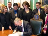 Watching as Governor Baker signs my consumer protection legislation into law